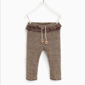 Pants with ruffle waistband & pompom tie